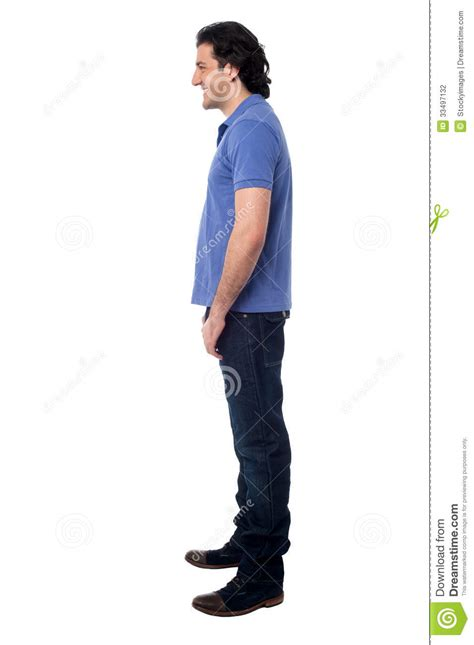 standing sideways side pose of smart studio stock photo