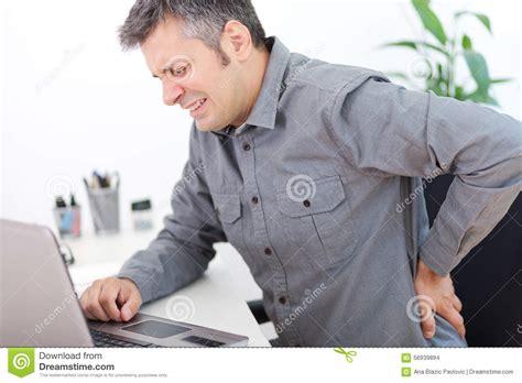 back pain from sitting at desk back pain stock photo image 56939894