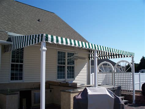 eastern awning eastern retractable awning with a drop screen kreider s