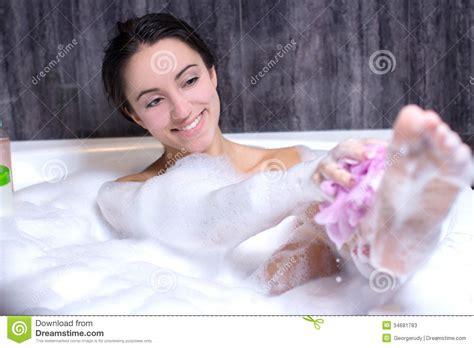 washing clothes in bathtub woman takes bath stock photos image 34681783