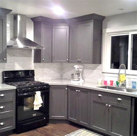 grey cabinets black appliances silver hardware tile backsplash really exle