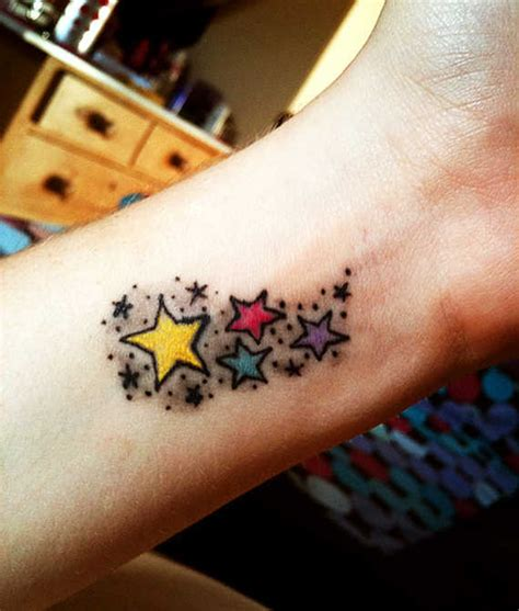 watercolor star tattoo convey a message through wrist tattoos
