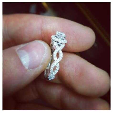 infinity twisted band halo style engagement ring halo