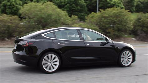 Who Is Tesla New White Tesla Model 3 Photos Give Better Look At Design