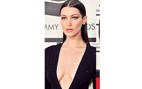 slicked back down the middle hair 10 easy ways to steal bella hadid s style the trend spotter