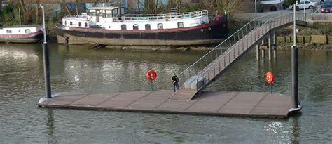 thames river boats from kew new rowing pier at kew bridge river thames beckett rankine