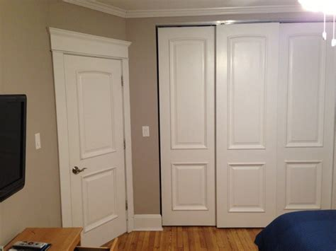 White Wood Sliding Closet Doors White Primed Solid Wood Closet And Sliding Doors With Raised Moulding Modern Wardrobe By