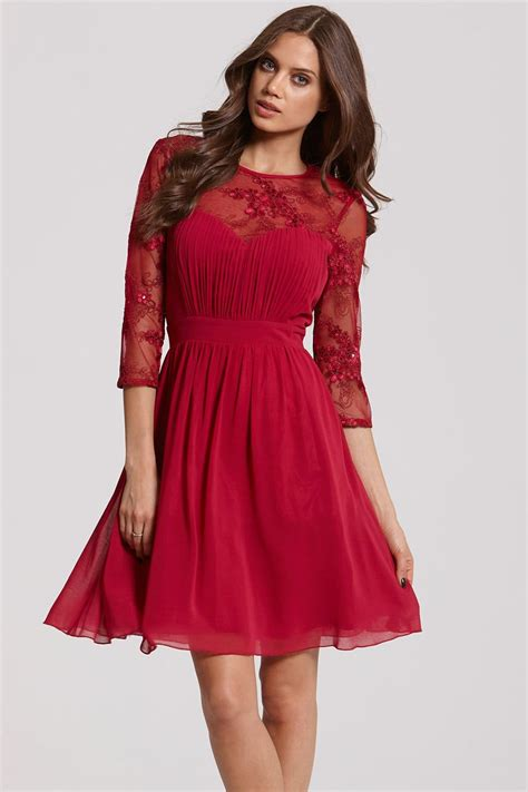 Dress Flare An berry and gold sequin fit and flare dress from