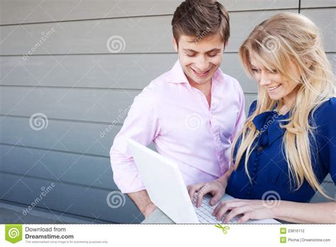 professional couple happy young professional couple using laptop stock
