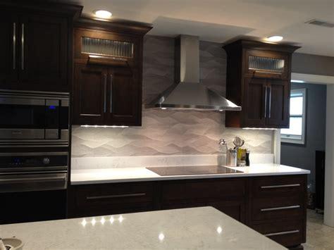75 kitchen backsplash ideas for remodeled kitchen wavy porcelanosa backsplash ge monogram induction cooktop cambria countertop