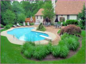 Swimming pool landscape ideas with flowers and shrubs home design