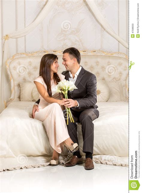 romantic couple in bed images romantic couple in love sitting on bed in luxurious room