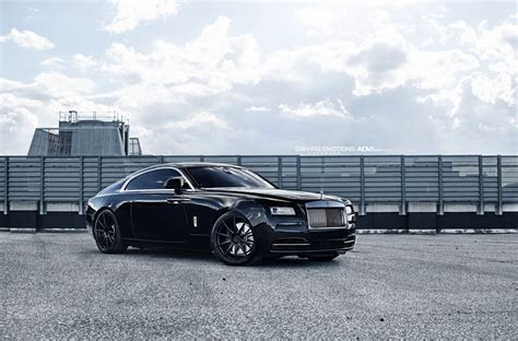 roll royce wraith on rims rolls royce wraith poses on 22 quot matte black wheels
