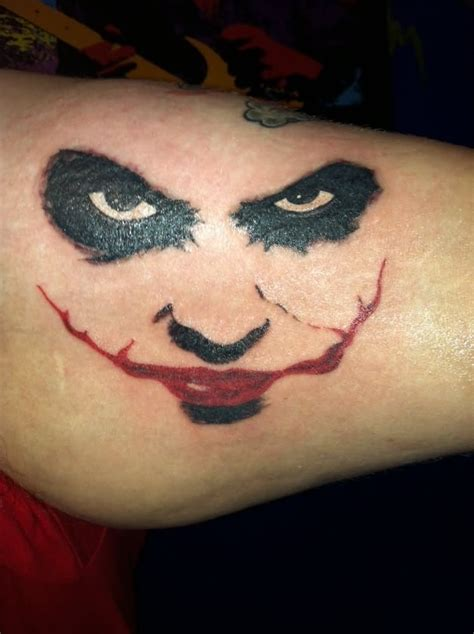 joker smile tattoo 30 awesome heath ledger joker tattoos