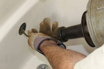 how to snake out a bathtub drain sewer backup cleanup repair harford county md