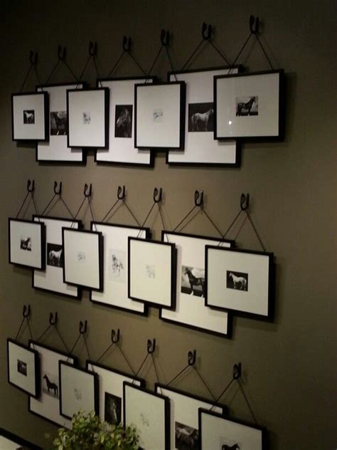 here s a rather unique idea for a gallery wall of stacking frames it makes it easy to switch
