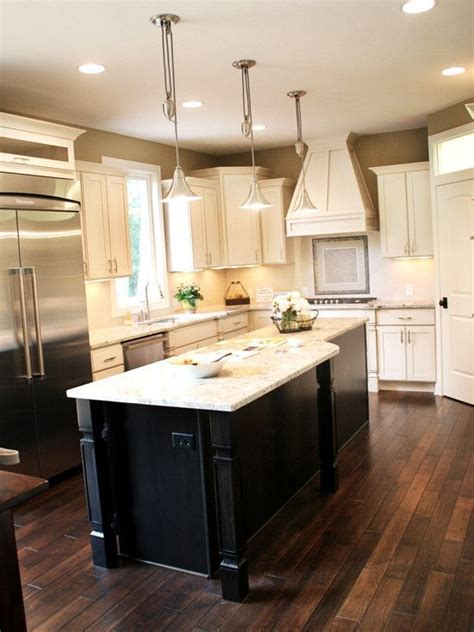 white kitchen with black island wood floors with cabinets and island kims special board