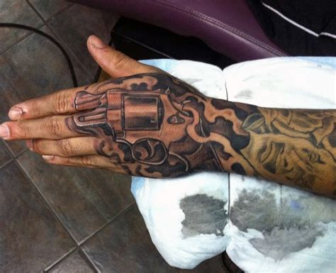 gun tattoo on hand 50 gun tattoos for explosive bullet design ideas
