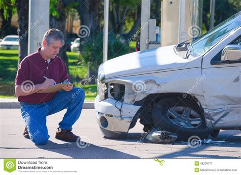 Auto Insurance Adjuster Inspecting Accident Claim Stock