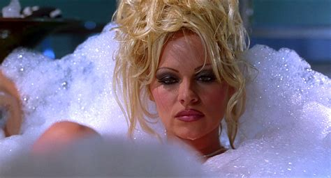 pamela anderson tattoo removal in barb wire