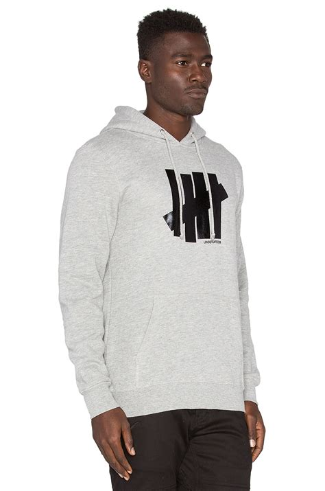Jaket Zipper Hoodie Sweater Undefeated Hitam 4 undefeated 5 strike hoody in gray for lyst