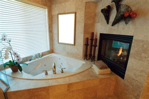 fireplace in bathroom wall 18 master bathrooms with fireplaces pictures