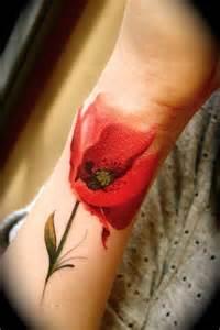 red abstract flower tattoo on wrist tattooshunt com