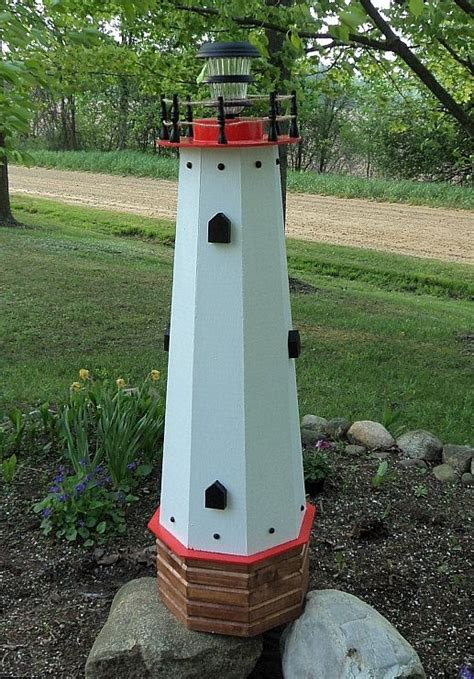 solar garden decorative lighthouse 48 quot solar lighthouse wooden well cover decorative