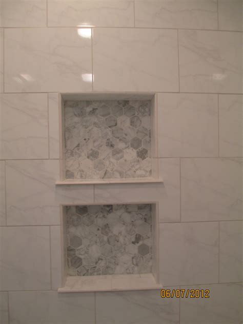 marble bathroom tile ideas hexagon carrara marble tile in back of shower niche red