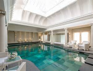 Room gymnasium and a huge swimming pool room with vaulted ceiling and