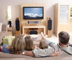 asian family watching tv together in living room this is families watch more tv than ever but in separate rooms