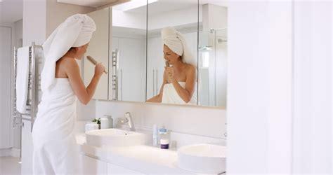 beautiful singing in bathroom wearing white towel