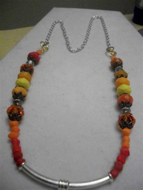 preteen jewels silver tube necklace orange yellow brown beaded necklace