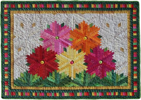 Log Cabin Patchwork History - zinnias by flavin layout for log