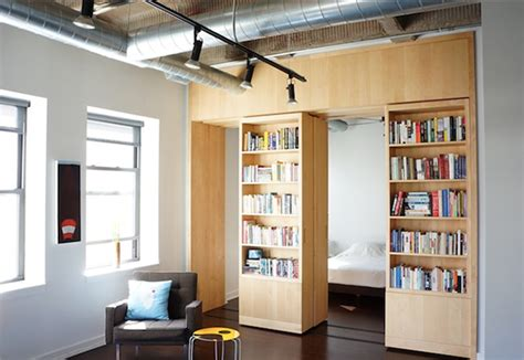 bookshelf partition how to get more out of your walls rolling bookshelves