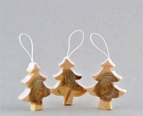 wooden christmas decorations created from juniper tree
