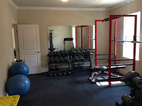 exercise equipment in bedroom well equipped bedroom gym complete with stall mat
