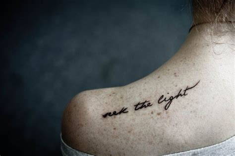 tattoo on shoulder lyrics seek the light for emma shoulder tattoo in black ink