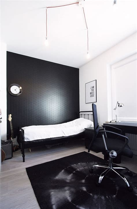 black bedroom wall scandinavian home decor mixed with a minimalist use of