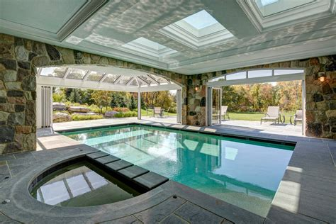covered pools indoor outdoor pools exterior traditional with backyard