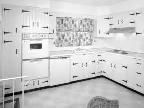 kitchen interior with white wood paneled cabinets with