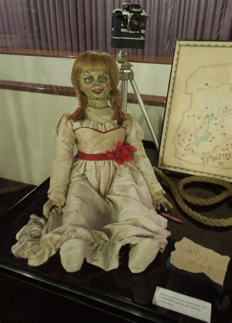 annabelle doll exhibit costumes and props the conjuring screen