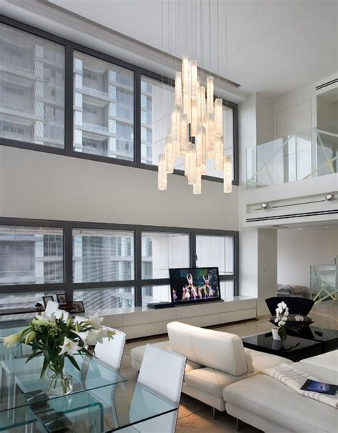 high ceiling living room modern living room miami white candles chandelier by galilee lighting