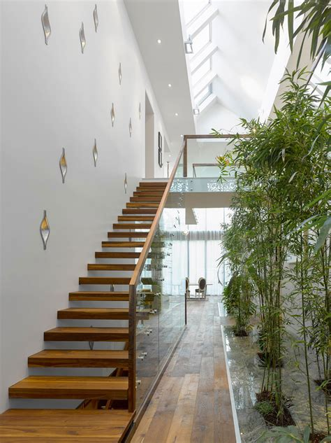 modern custom home  central atrium  interior bamboo