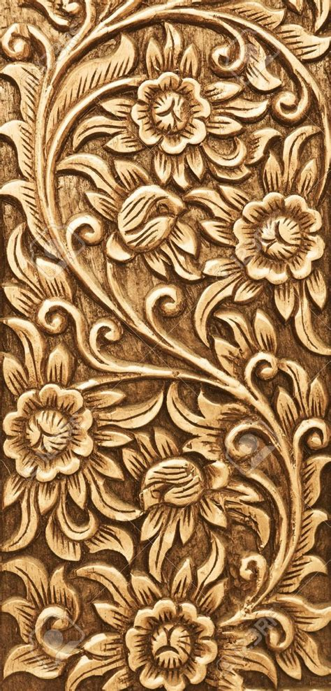 Ready Senin Animal pattern of flower carved on wood background stock photo