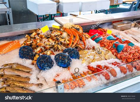 Seafood Shelf by Various Seafood On The Shelves Of The Fish Market In