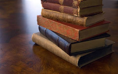 books wallpaper a stack of old books on a wooden surface wallpapers and