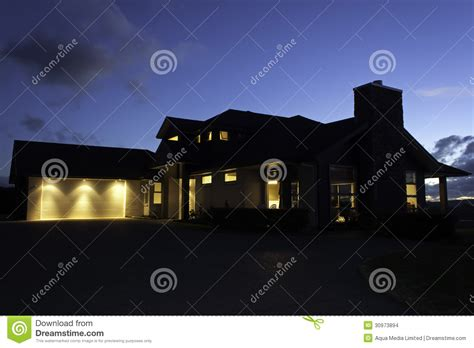 house lighting modern house exterior with lighting at night stock photo