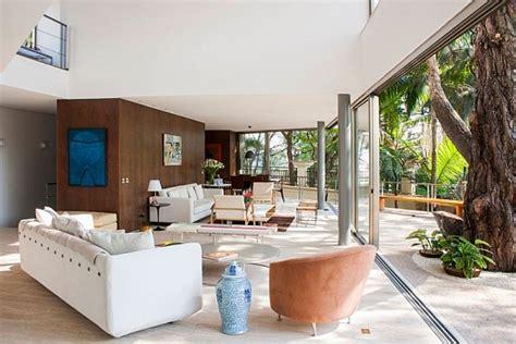 inside outside living room offset house in brasil brings the outdoors inside in style