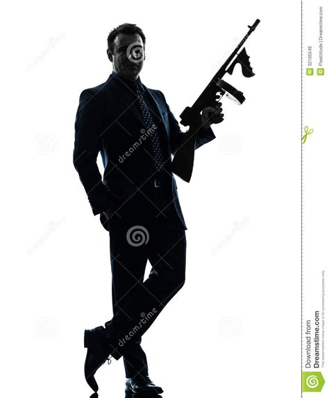 man holding gangster man holding thompson machine gun silhouette stock